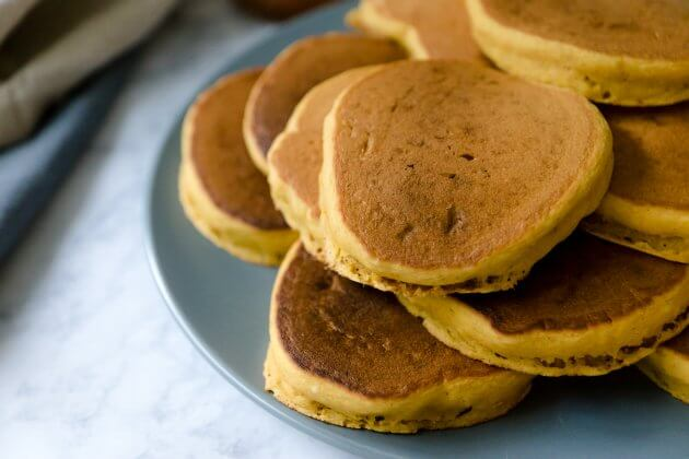 Use this quick hack to make pumpkin spice pancakes using your favorite buttermilk pancake mix. Excellent for a fall mornings or holiday breakfasts.