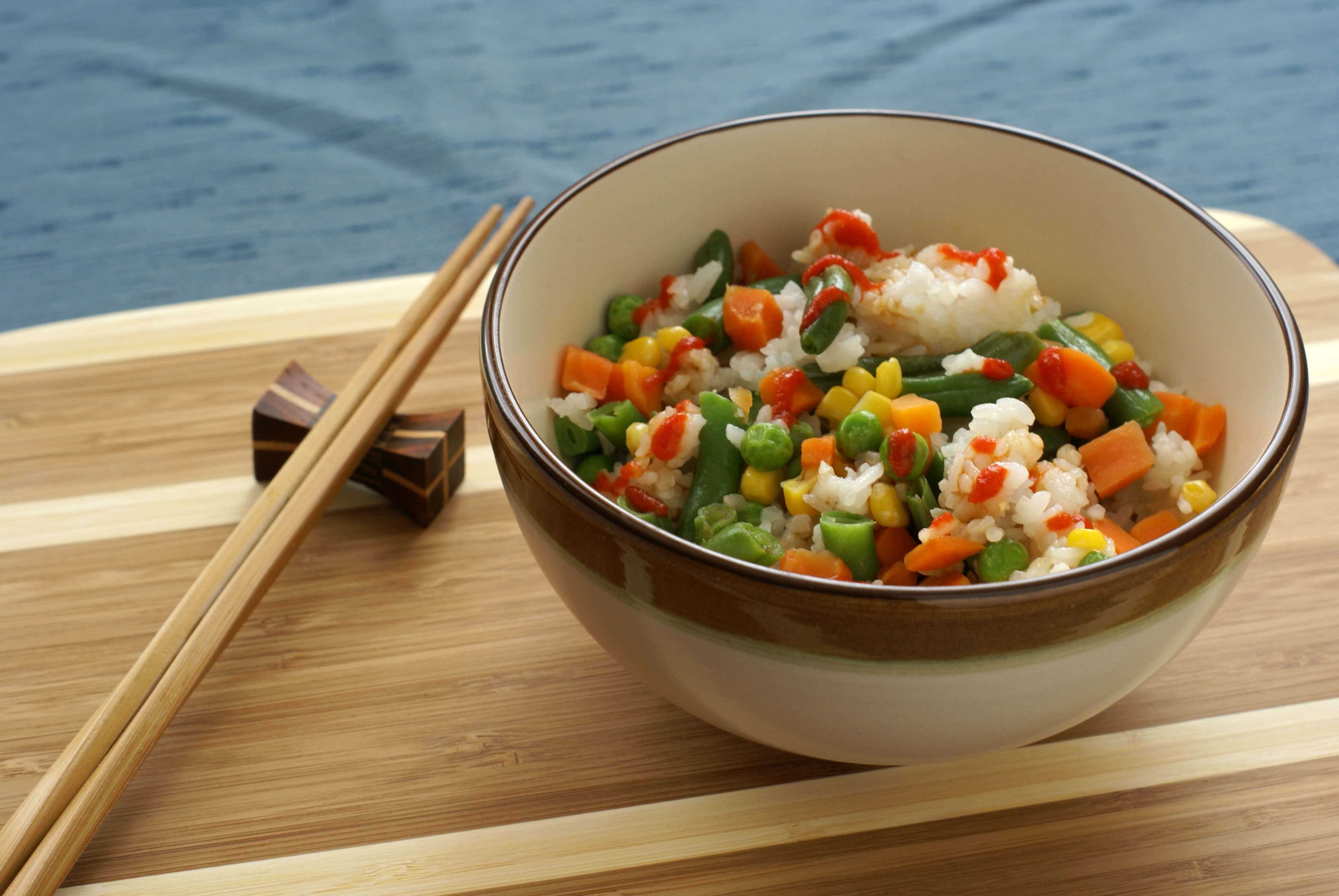 chop sticks with bowl of rice and vegetables