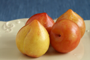 Plate with four lemon plums