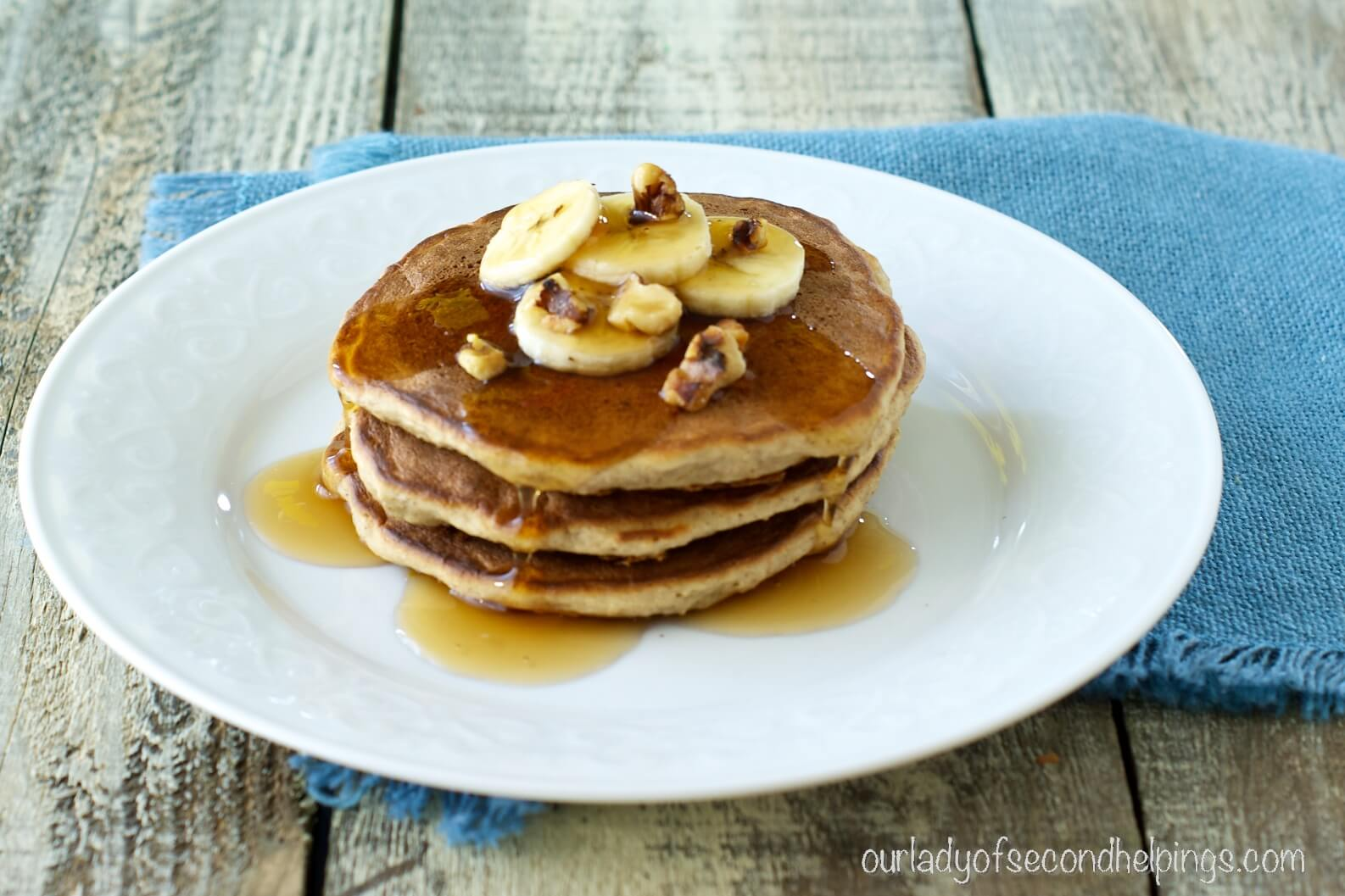 banana bread pancakes with syrup and walnuts