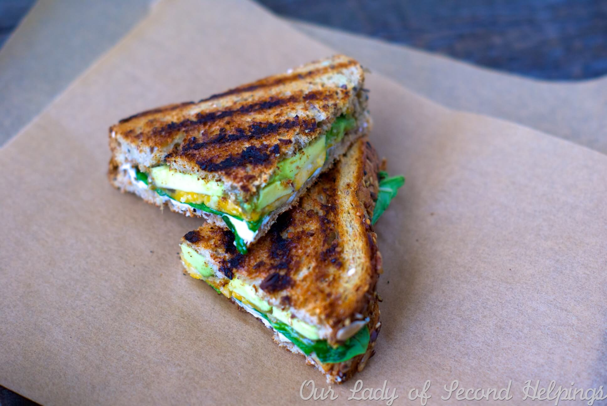 Three cheeses creamy avocado and toasty multi-grain bread make this avocado grilled cheese sandwich an indulgent lunch time treat.