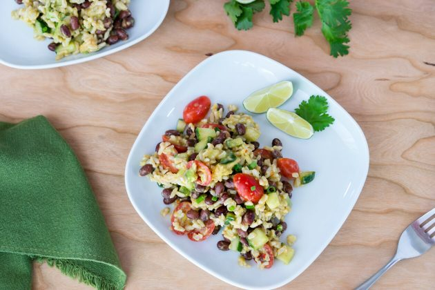 A zesty chili-lime dressing give this black bean & rice salad a great kick. Serve as a side dish as is or over leafy greens.
