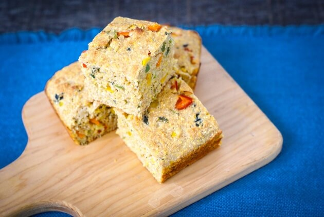 Eye catching confetti cornbread is a colorful addition to a barbecue with bursts of sweet corn and spicy jalapeños. You will love this quick & easy recipe.