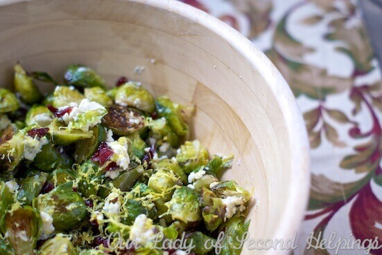 Roasted Brussels Sprouts with Gorgonzola & Cranberry are a stunning side dish. Easy, healthy and so flavorful! Make this recipe your signature holiday dish.