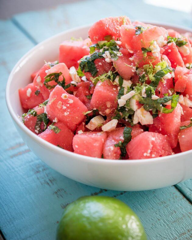 Watermelon salad with mint, feta, & spicy jalapenos - give this summer favorite a zesty twist. Quick & Easy recipe for picnics and barbecues.