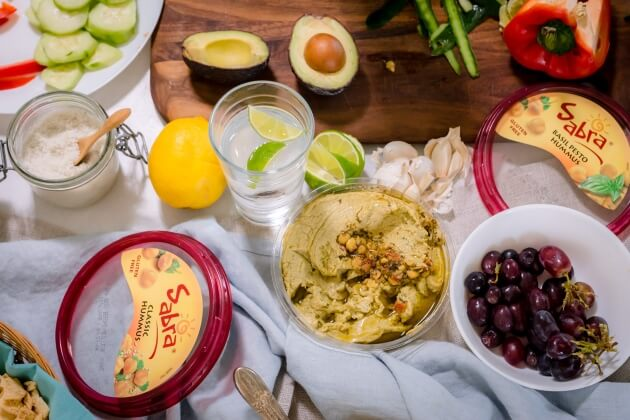 Give hummus a quick and easy makeover with an avocado-lime hummus topping. Perfect easy appetizer, tailgate food, or healthy snack recipe.