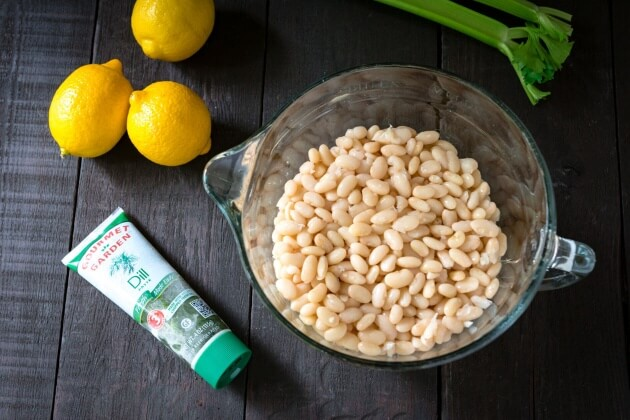 Thanks to the simple fresh flavors lemon dill navy bean salad has a lightness you might not expect from a bean salad. Quick & easy 15 minute no-cook recipe.