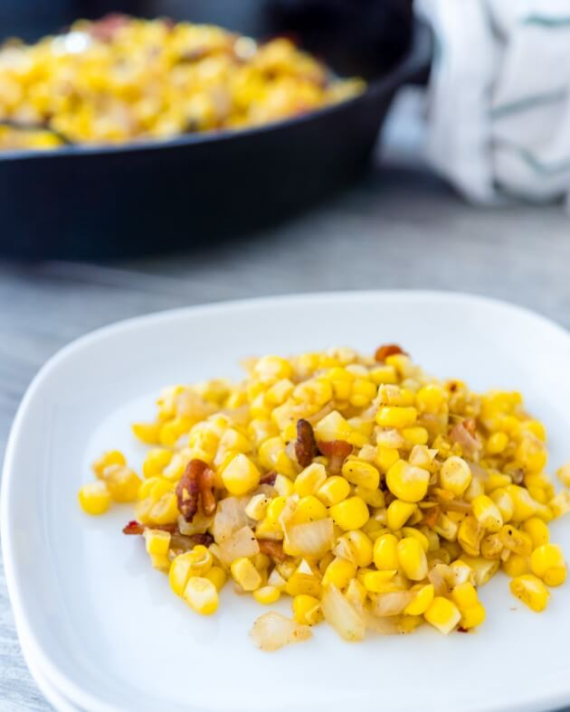 Tender fresh corn with crispy bacon is the exact right balance of salty with starchy sweet. An easy recipe for a healthy comfort food side dish.