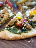 Pesto pita bread pizza is perfect comfort food for when life gets busy. Let your family customize their pizzas. This is a recipe everyone will love!