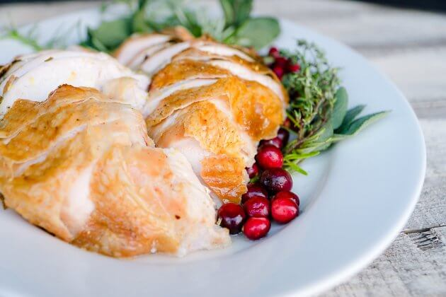 Roast turkey breast turns out tender and flavorful with this easy recipe using lemon-herb butter. Perfect for small holiday meals.