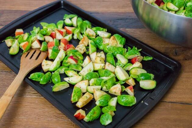 Rosemary roasted Brussels sprouts with apples; seasoned with a mixture of sweet apple, bright citrus, and aromatic rosemary.