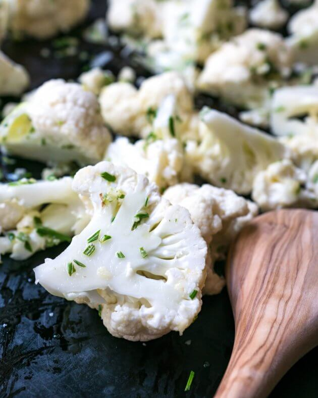 Roasted cauliflower with rosemary and sea salt is a perfectly elegant no-fuss side dish. A healthier alternative to potatoes and other starches.